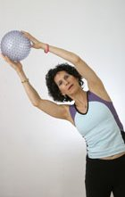 woman holding a ball for exercise